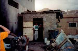 Bob & Kodra in Kodra's doorway. The small space is her home.