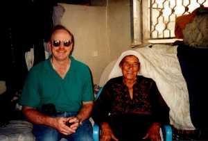 Ministry partner Steve Walker and Kodra inside her house.