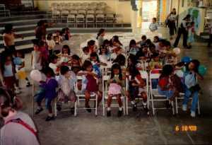 Handing out school supplies