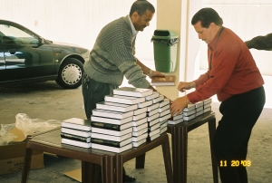 Putting out Bibles to be given to the people.