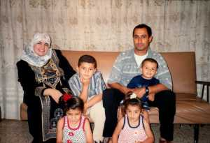 Woofaa, Hassan, Kahjlil holding Mohammed. Ressan, Jeanan